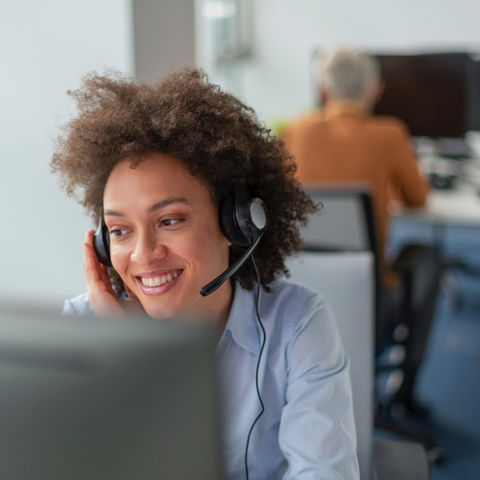 Woman with a headset answering a call