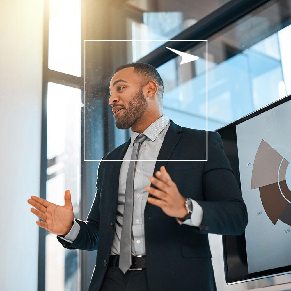Man presenting data on tv screen
