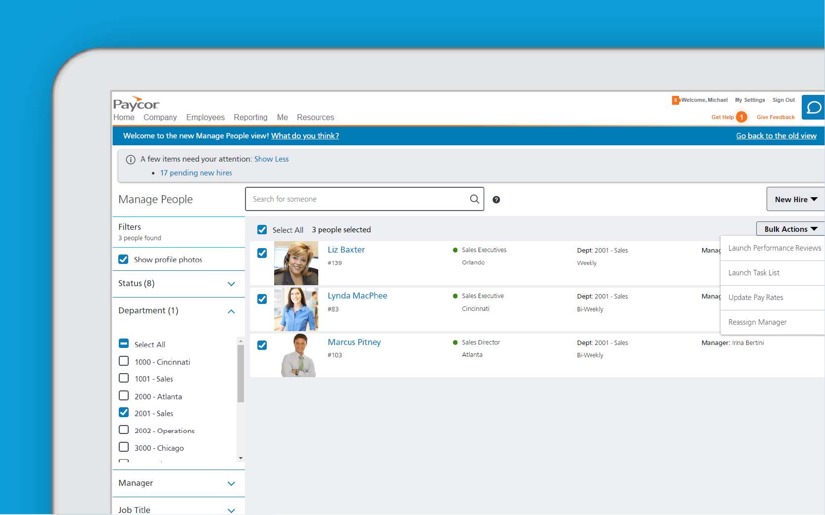 Corner of tablet showing Paycor compensation dashboard against blue background