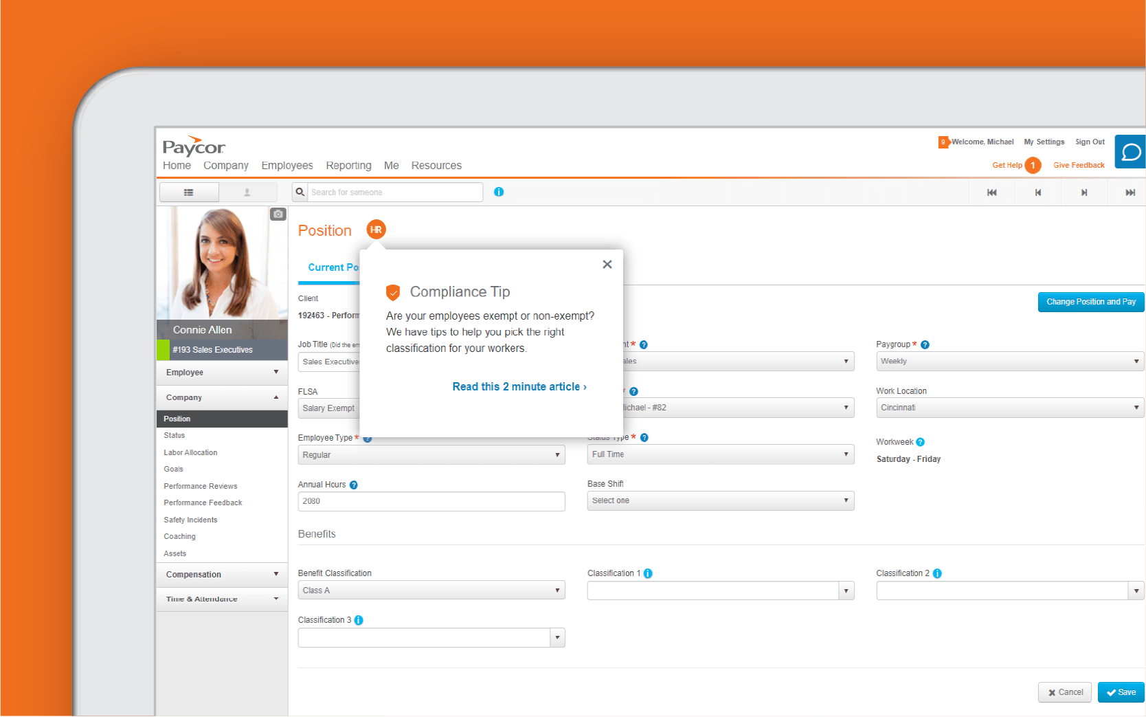 Corner of tablet showing employee experience dashboard against orange background