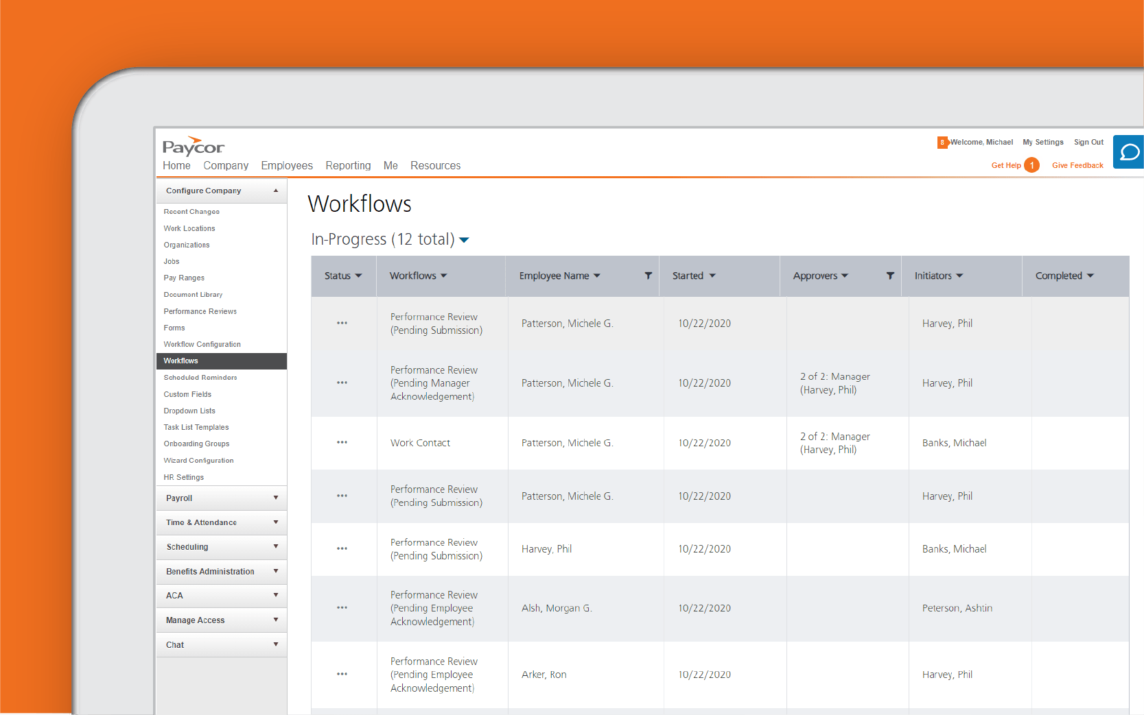 Corner of. tablet showing workflow dashboard against orange background