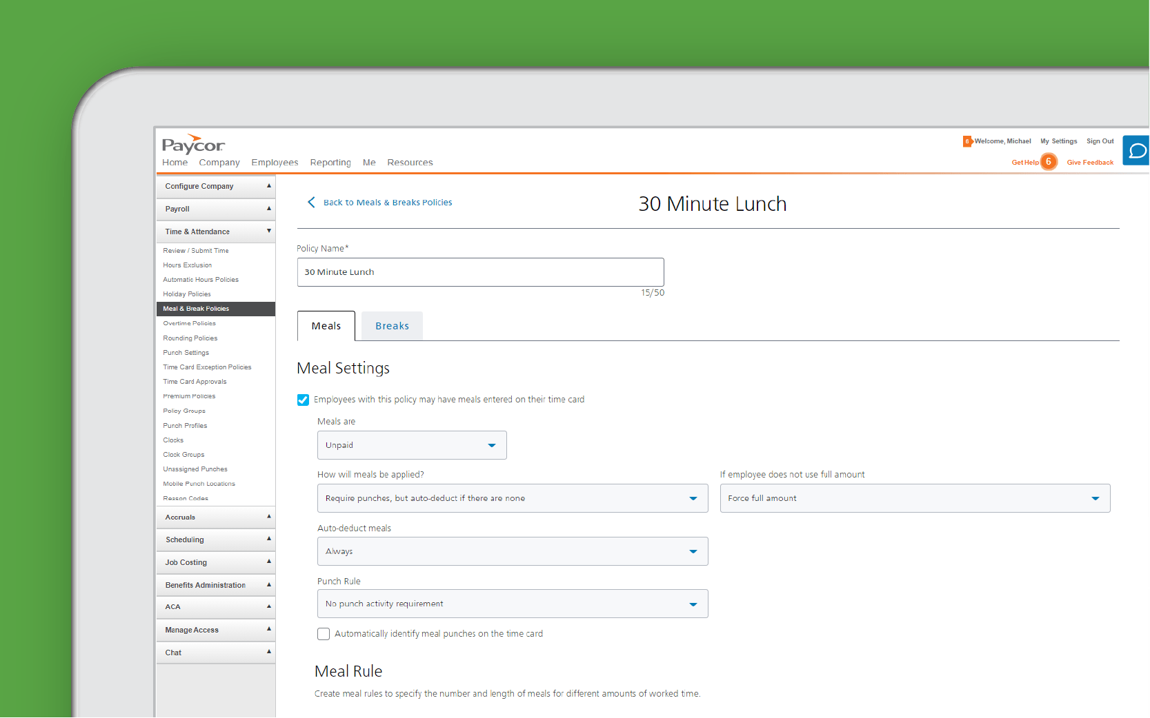 Corner of tablet showing Paycor compliance checks against green background
