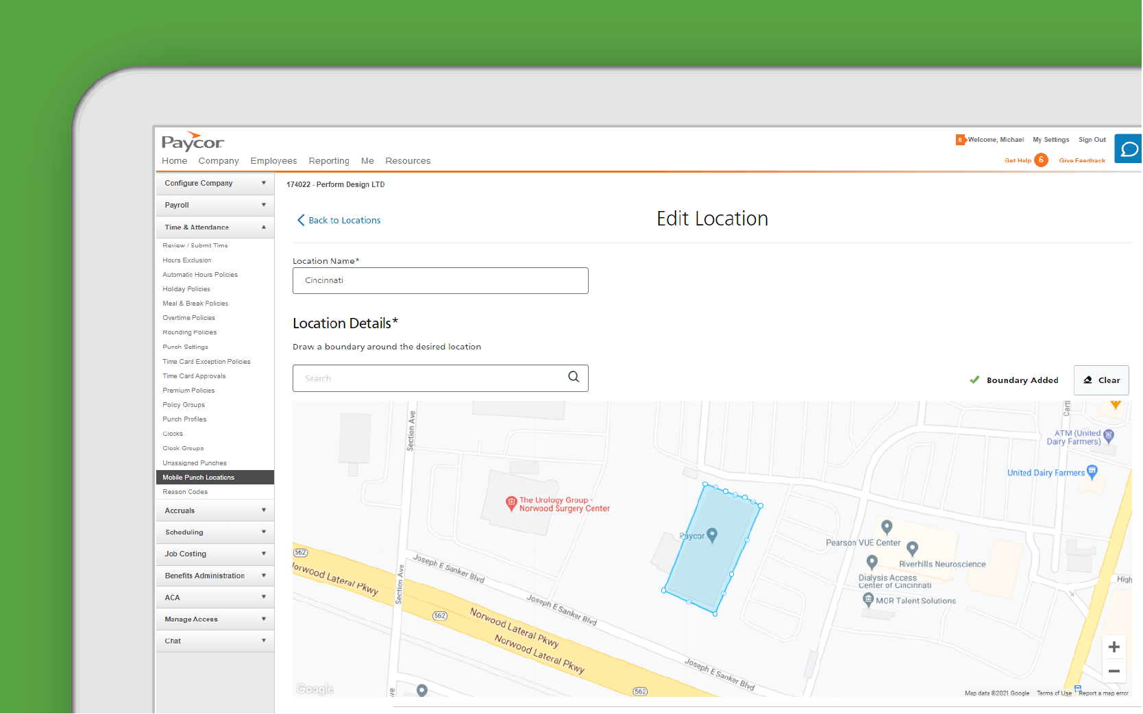 Corner of tablet showing Paycor geovalidation against green background